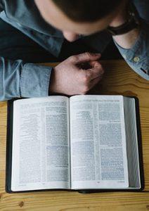 Visit Us - Man Studying Bible