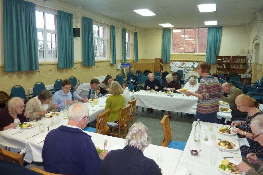 Shrewsbury Christadelphians Eating A Christmas Meal round tables